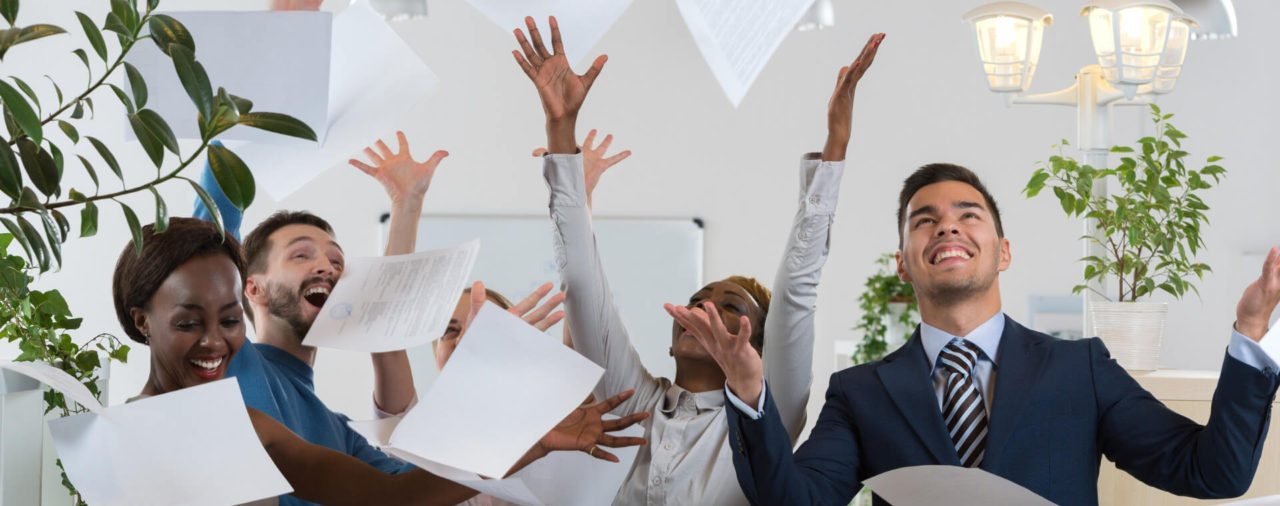 Group of People Throwing People in the Air at Work